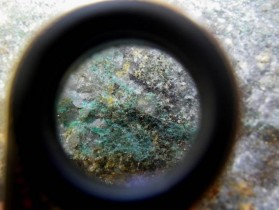 Chalcopyrite mineralisation and malachite staining magnified